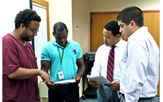 (From left) James Allen, Wendell Jones, Jabari Elliott and Jaime Vaquer-Alicea III are scholars in a program, funded by the National Institutes of Health, that promotes diversity in the university's PhD training program in the biomedical sciences. Not pictured is Calvin Stephens.  Photo by Gaia Remerowski