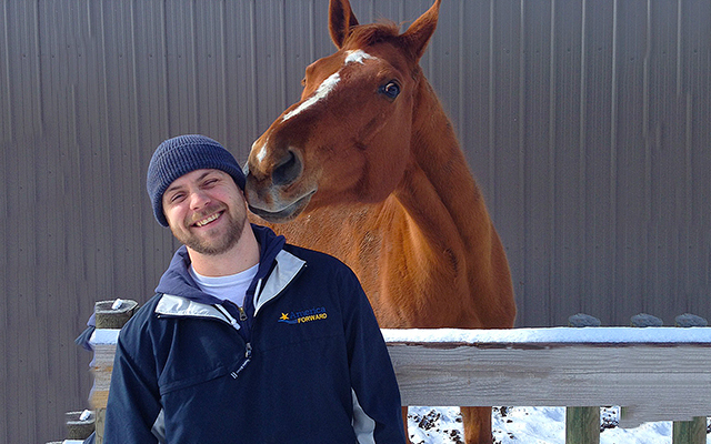 Veteran Ian Smith works with horses in the Pathfinders Initiative, a program developed by best friend and fellow Washington University student Mike Pereira. Like many returning veterans, Smith and Pereira continue to serve their nation through community service and social entrepreneurship.