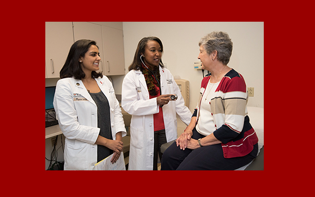 Angela L. Brown, MD, (center) runs the Hypertension Clinic at Washington University. Brown helps Karen Carriker (right) and other patients control high blood pressure. She also provides training for health-care professionals, such as cardiology fellow Nishtha Sodhi, MD (left), in how to care for patients with hypertension. Photo by Robert Boston