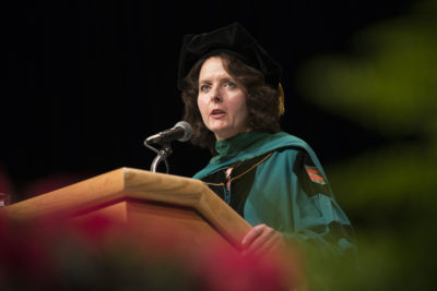 Alison Whelan speaks in cap and gown