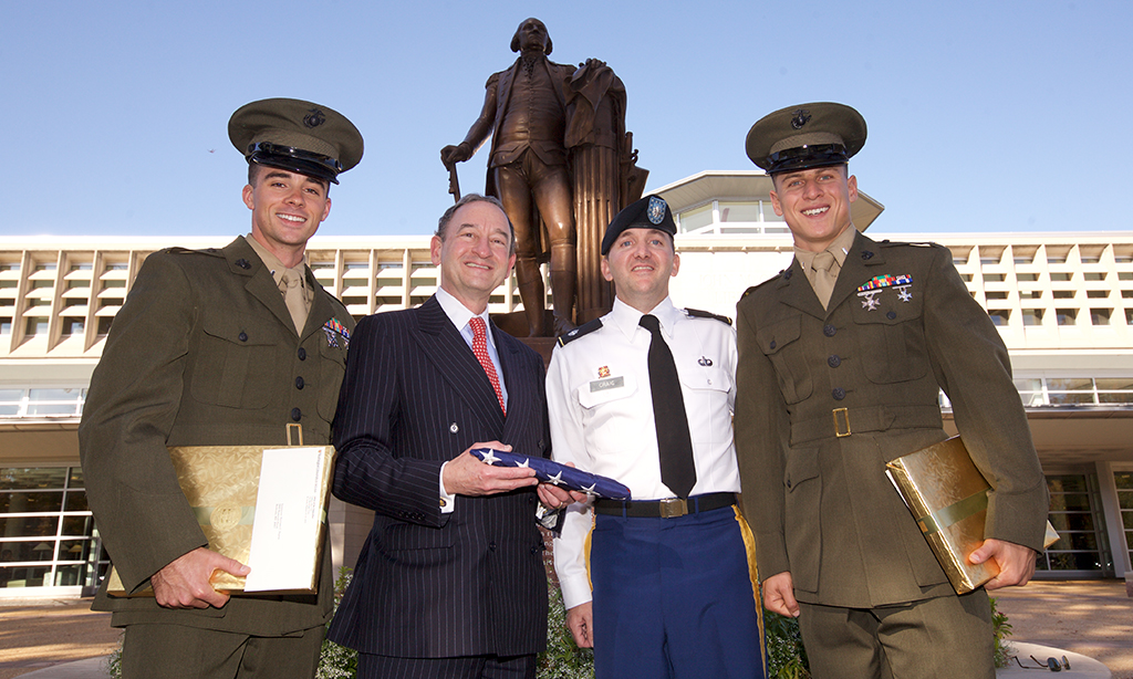 Chancellor Wrighton with Marine first lieutenants Harrison Suarez and Michael Haft